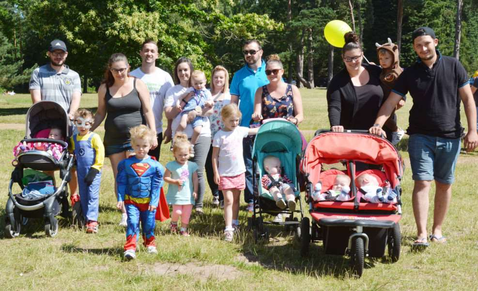 BIG TODDLE AT SANDRINGHAM'Charlotte and Rob Ward, third and fourth back left, join one group of parents and toddlers as they set out on their Big Toddle