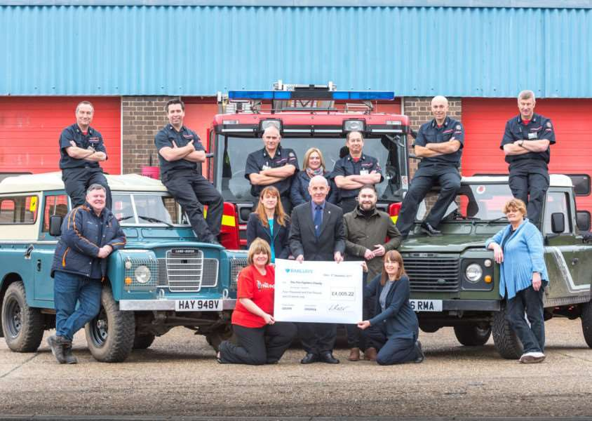 Norfolk Fire and Rescue Service and event sponsors present a cheque to The Fire Fighters Charity following the first charity Landrover Run. ''Front LtoR - Warren Boore (optima stainless), Claire Boer (The Firefighters Charity), Natalie Endersby (Barclays), Ken Reynolds (The Firefighters Charity), Tim Kavanagh (Adrian Flux), Lynn Twite (Lynn Firestation), Sue Rogers (Lynn Firestation). 'Back LtoR - Grant Cotterell, Scott Norman, Clive Wells, Dawn Ayers, Les Britzman (assitant chief fire officer), Bob Ayers and Mick Whitby.