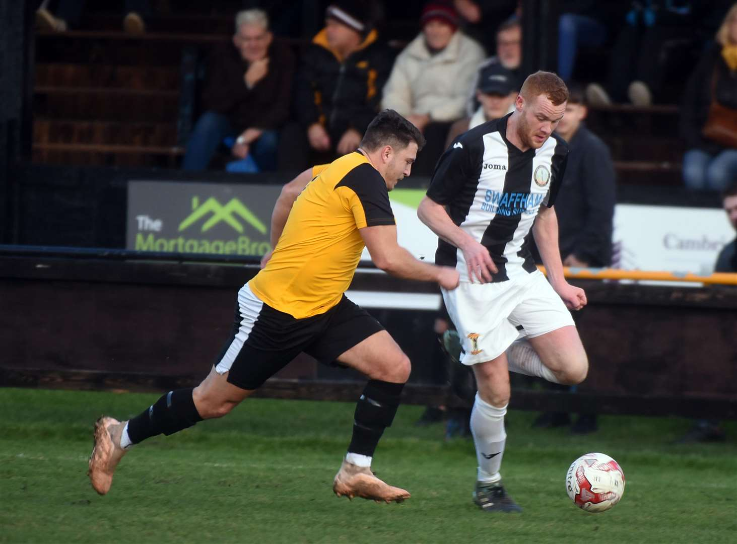 Kyle Plumb, far right, in action for Swaffham Town at March Town. (6302818)