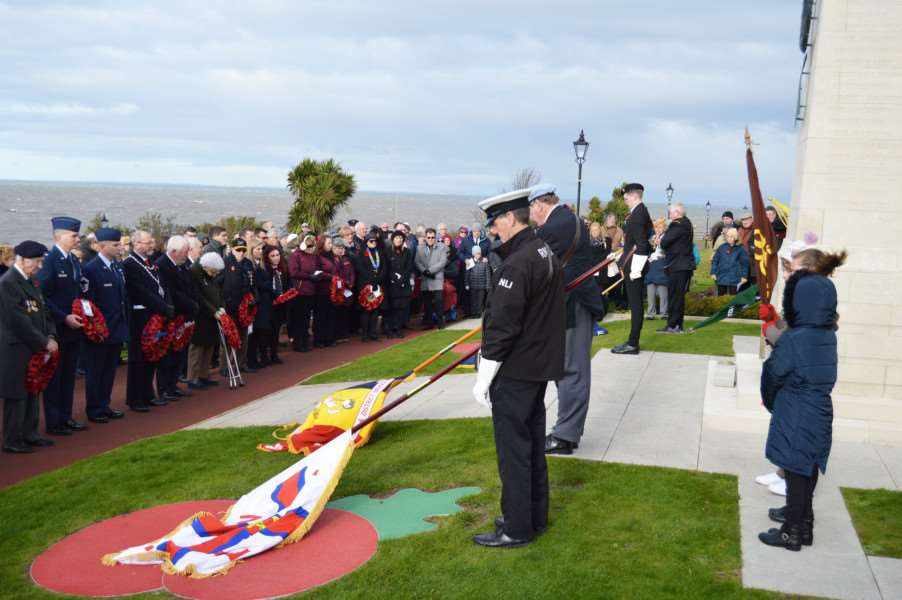 Standards are lowered during the Remembrance Sunday service in Hunstanton