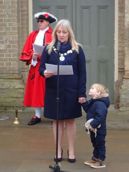 Deputy Mayor of Downham Market, Yvonne Thompson, reads the Commonwealth Affirmation supported by her Grandson. Photo: SUBMITTED.