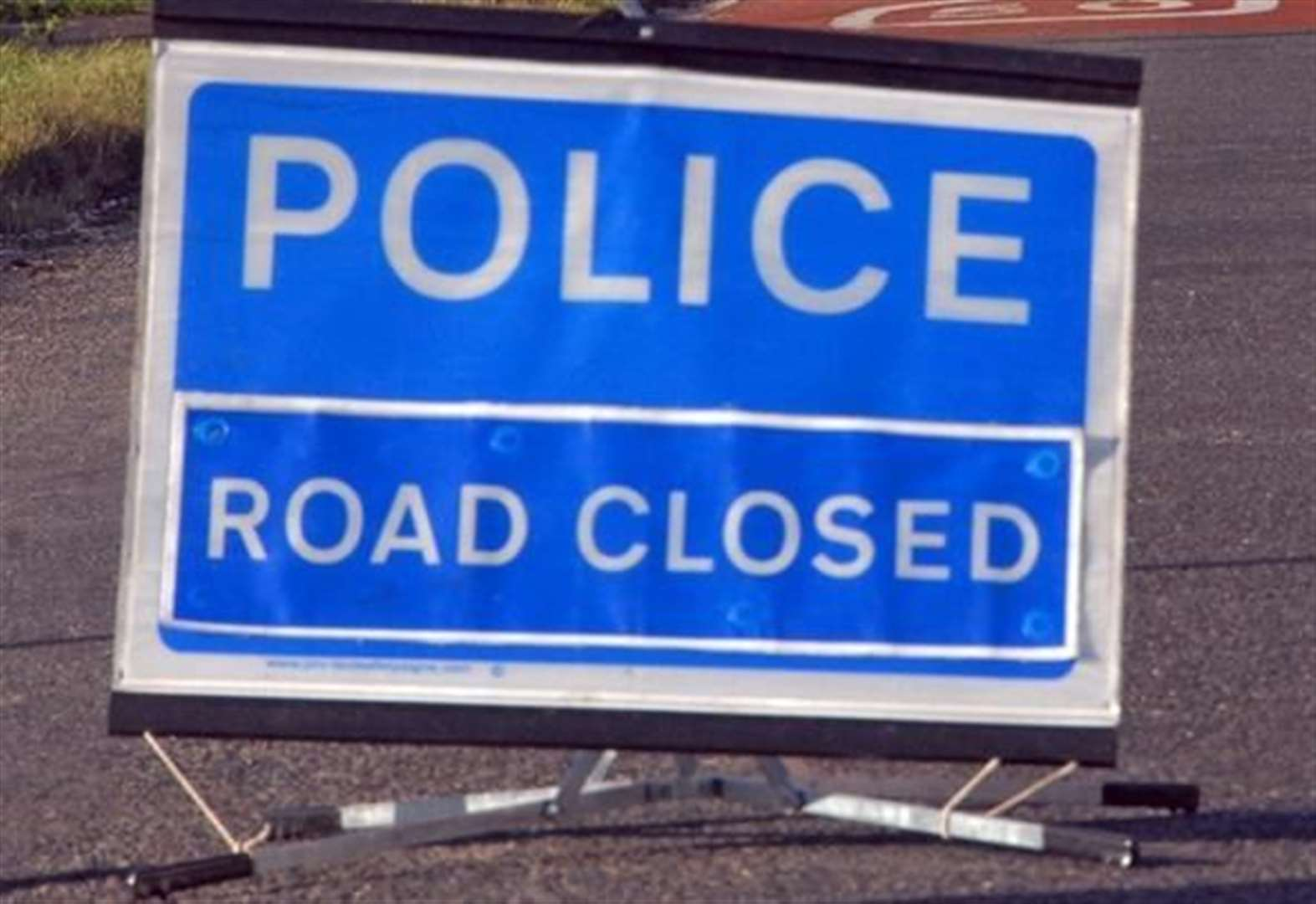 Road closed following serious collision between car and tractor