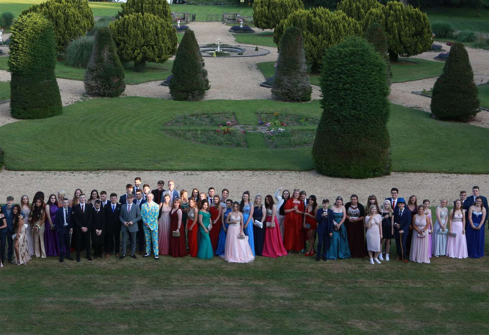 Pineapple suit, beautiful dresses, vintage cars and picturesque Lynford Hall setting for Swaffham school prom