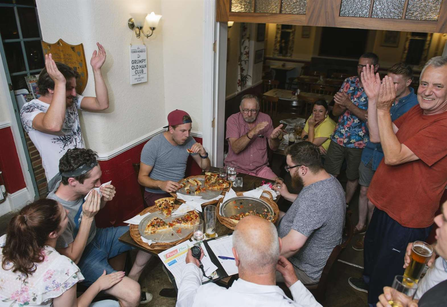 Pubgoers grab a pizza the action in charity task