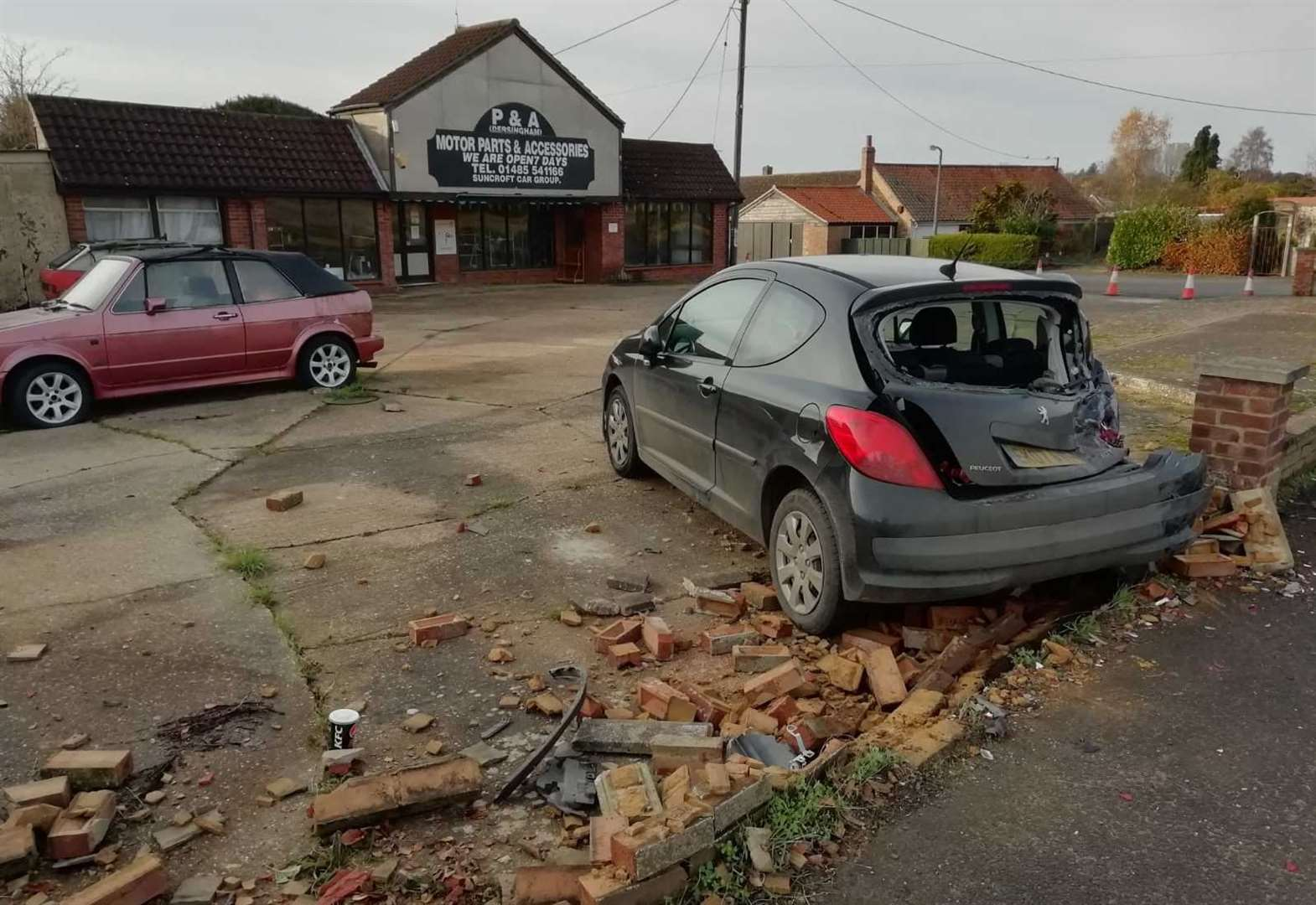 Stationary car badly damage after being 'rear ended' into wall in West Norfolk village