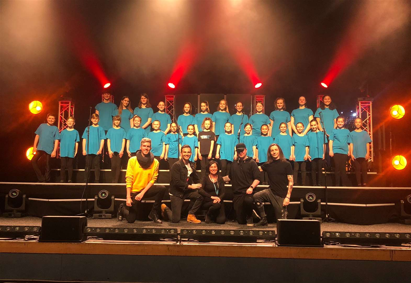 King's Lynn students accompany musical theatre boyband Collabro on stage