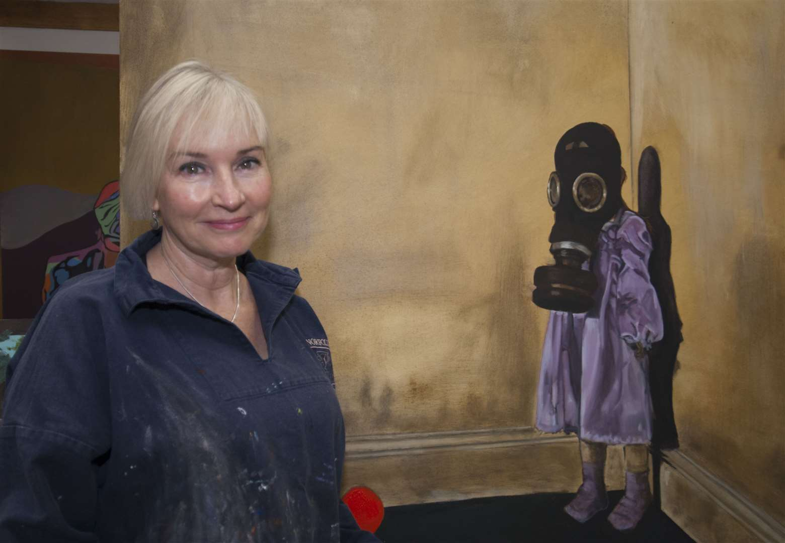 Terri Broughton with one of her paintings. Picture: SUBMITTED. (19834117)