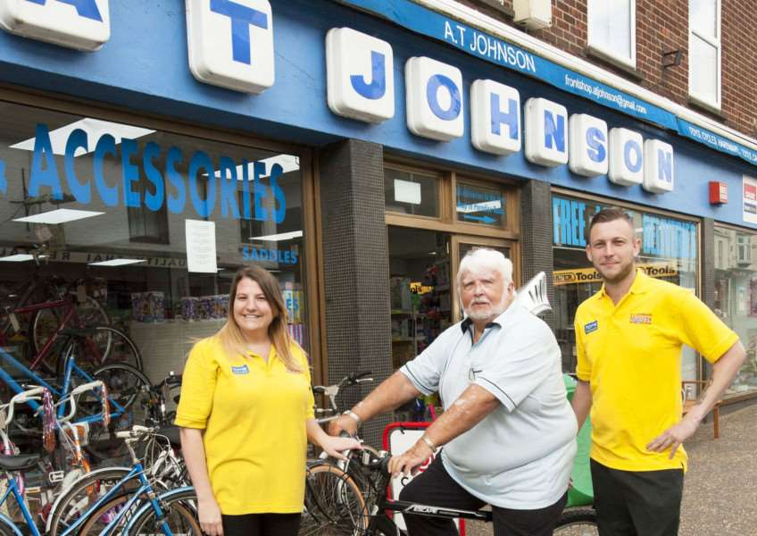 Bob Culley pictured centre at A.T.Johnsons Downham Market Winner of Pro-Bike Competition In The Lynn News. FLtoR Hannah Edwards. Bob Culley. Justin Eastman.