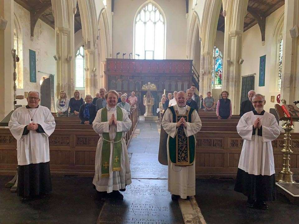 Clergy, servers, and worshippers after the 11am mass at All Saints' Church, South Lynn. Picture: SUBMITTED
