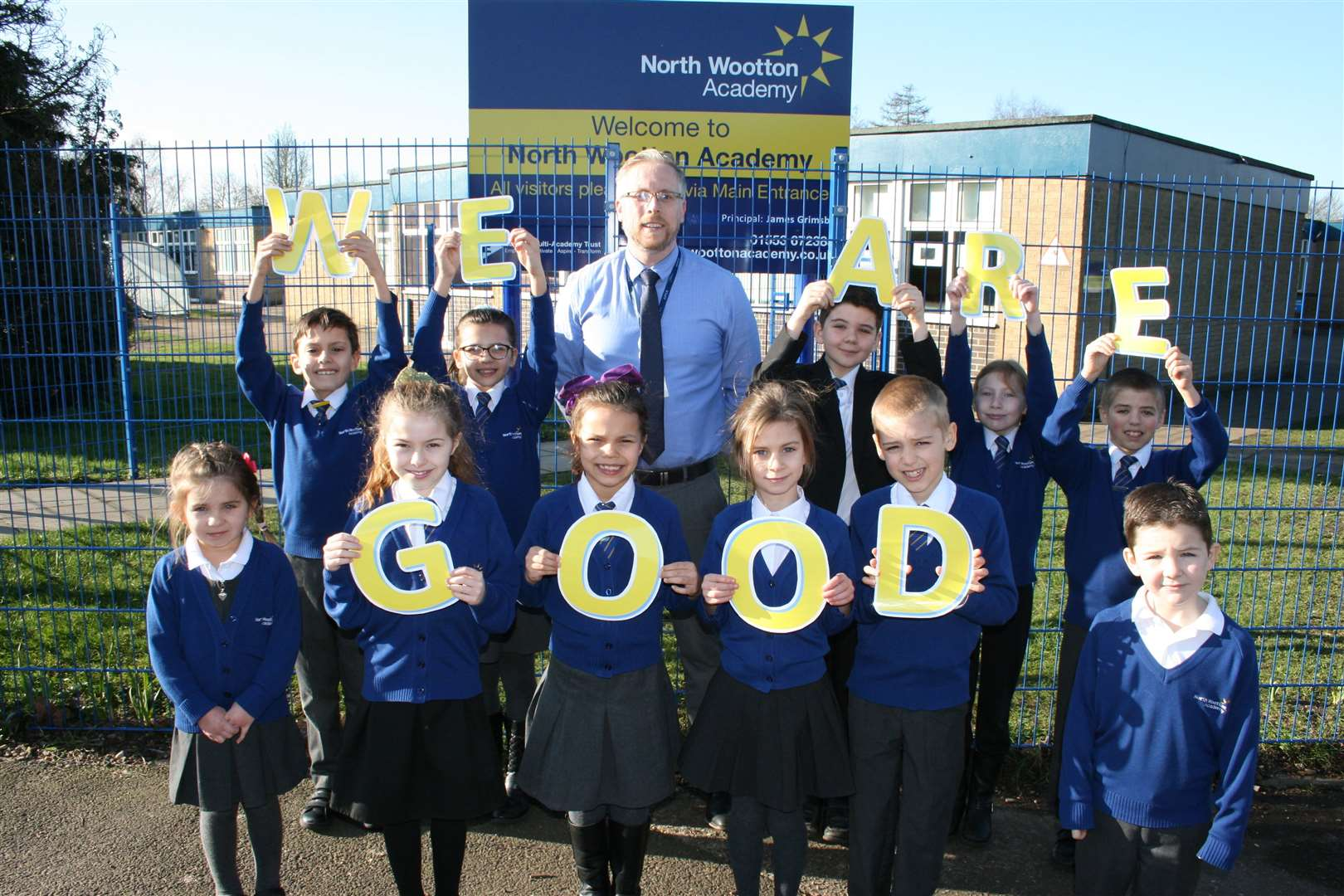 North Wootton Academy pupils celebrate their good Ofsted rating with principal James Grimsby