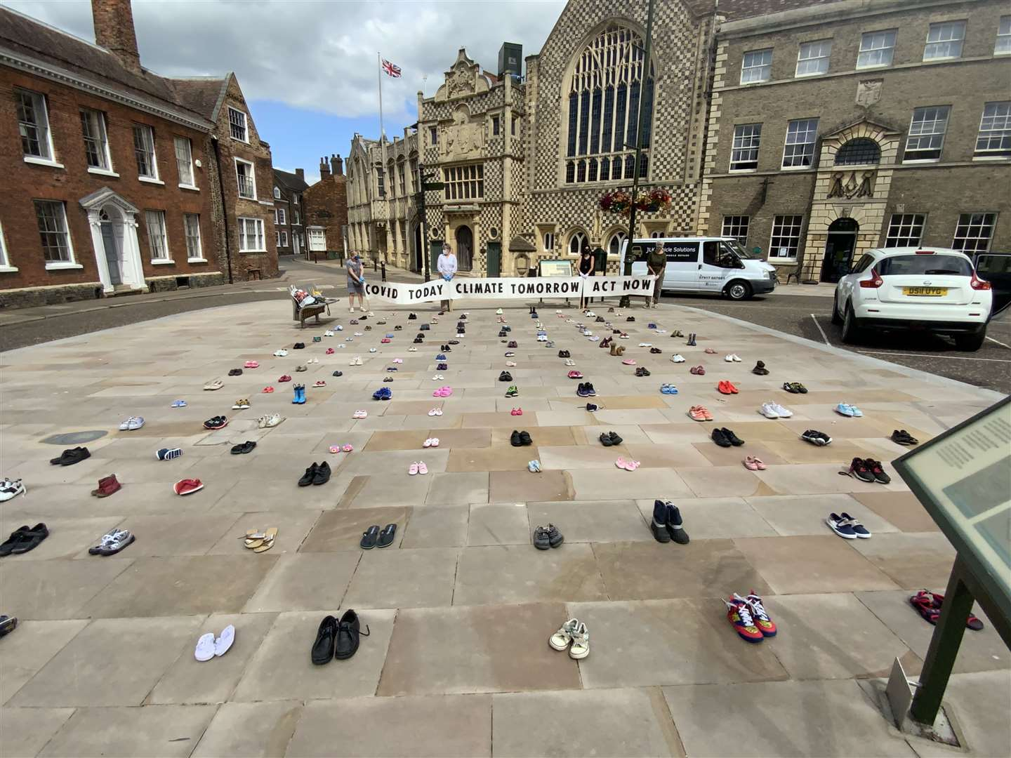 Extinction Rebellion staged a protest outside Lynn Town Hall by placing pairs of children's shoes on the ground as a symbol of the future generations who will be affected by climate change. Picture: SUBMITTED