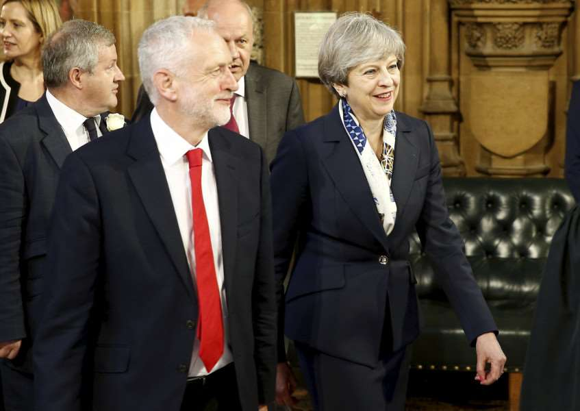 Theresa May and Jeremy Corbyn are seen in the Central Lobby of Westminster before HM The Queen reads the speech which marks the beginning of the parliamentary session, June 21 2017.