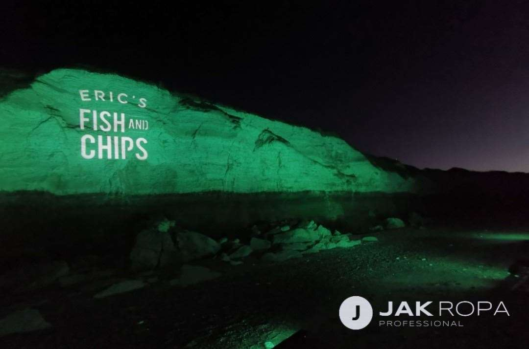 Jak Ropa lights up Hunstanton cliffs with a nod to sponsor Eric'sFish and Chips at Thornham. Picture: IAN WARD (43728814)