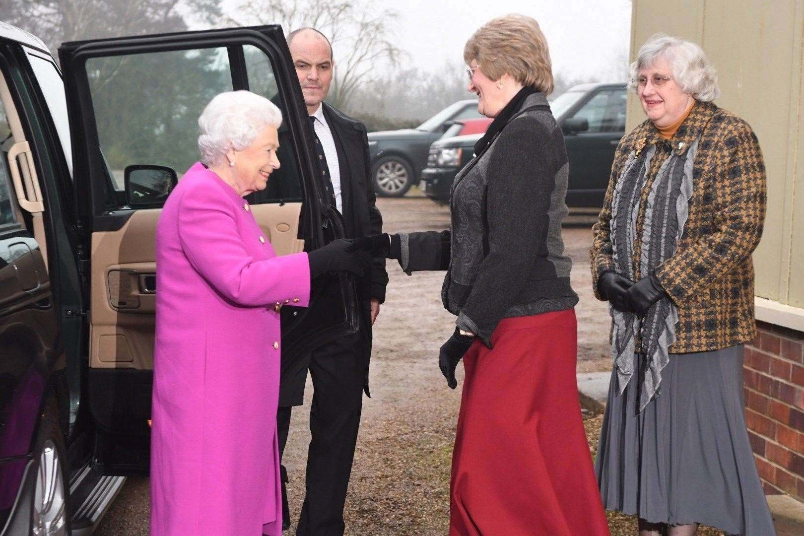 Yvonne Brown, Sandringham and West Newton WI chairman, greets the Queen at West Newton Village Hall.. (10821075)