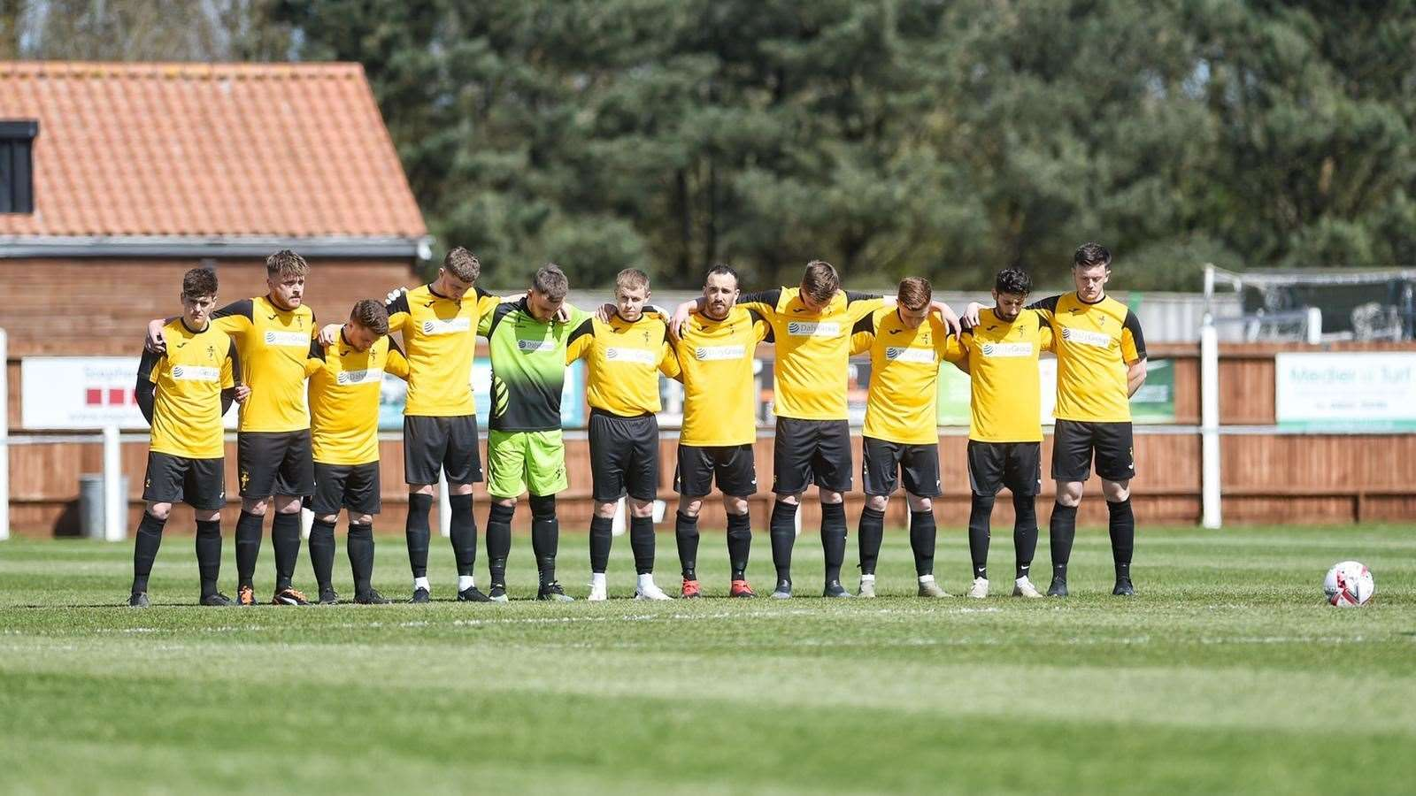 Fakenham Town players observes a minutes silence before the game. Picture: Ian Burt. (46277385)