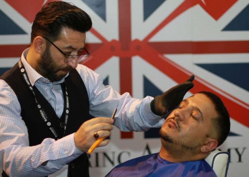 Lynn barber Yucel Olmezkaya, who has been selected to be employed by premium education service the Great British Barbering Academy.