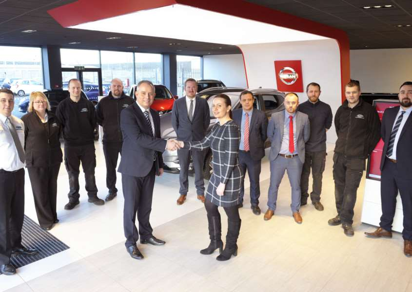 New Nissan dealership and showroom launched at EMG Motor Group Beveridge Way Hardwick Narrows King's Lynn 'EMG Motor Group King's Lynn General Manager Kurt Yates welcomes Lorraine Johnson from Nissan UK to the new showroon, along with other members of the Nissan King's Lynn Team.