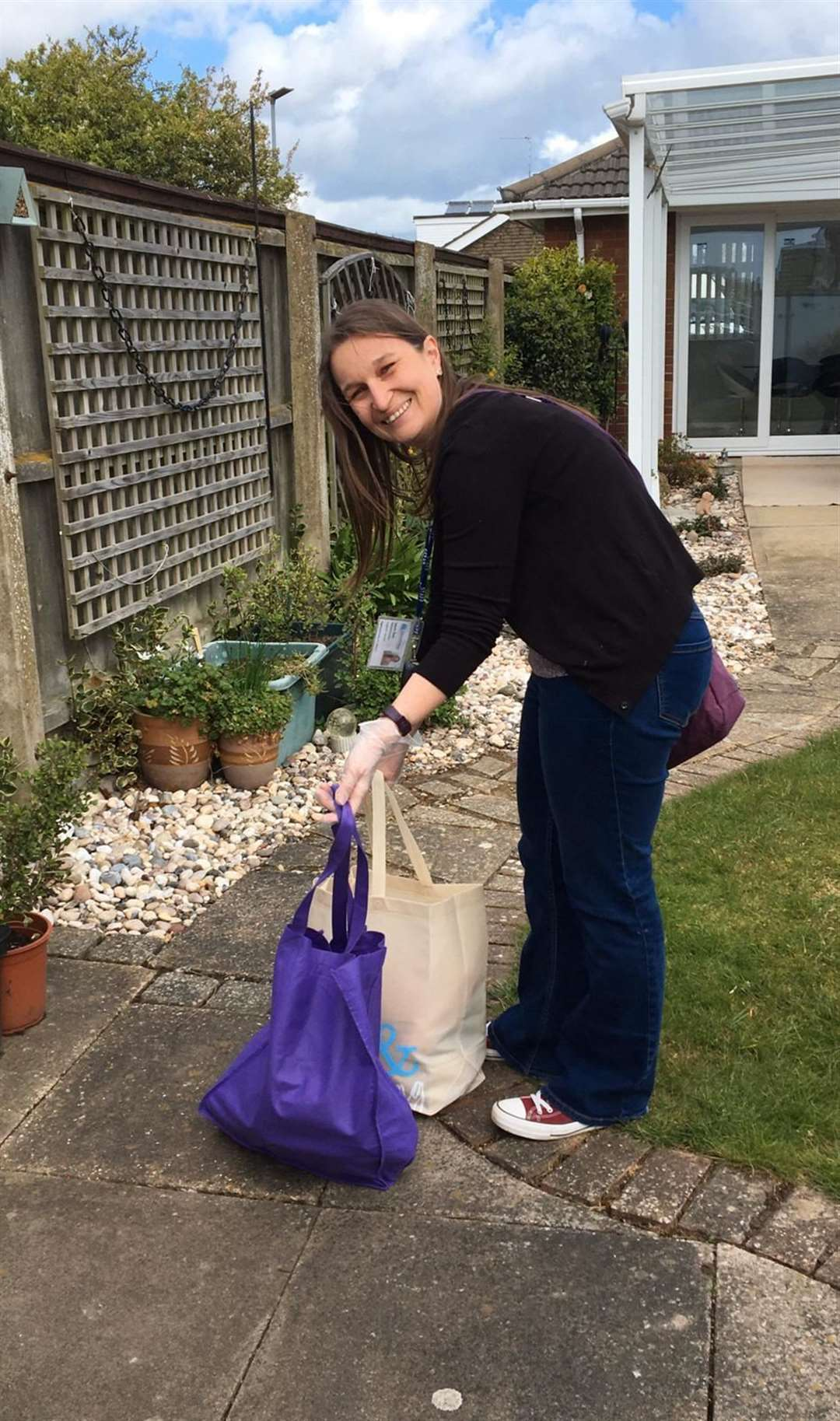 A Norfolk and Waveney Headway support worker delivering packages for clients. Picture: SUBMITTED
