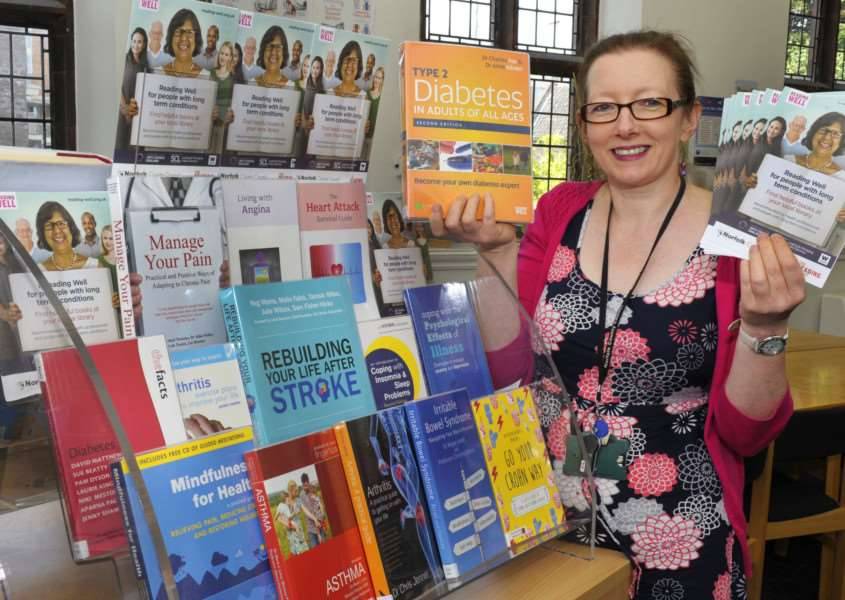 Launch of new reading for long-term conditions scheme at King's Lynn Library 'Community Librarian Alison Thorne with some of the books for the launch