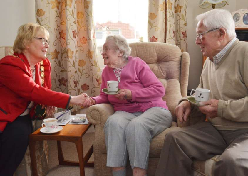 Royal platinum wedding anniversary'Carol Bower enjoys a cup of coffee with Winifred and Alan Webb