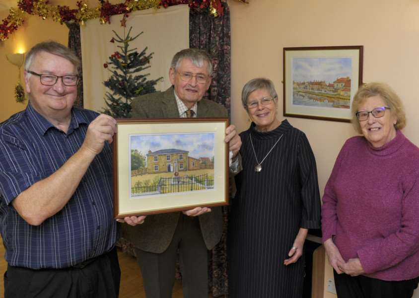 Nordelph Village Hall Committee thanks to artist Heinz Heisler for donation of three watercolour pictures of the village.'LtoR, Tim Spooner (Chairman of Nordelph Village Hall Committee), Heinz Heisler (Artist), Sue Venn (Arts and Craft Group), Daphne Chapman (Bingo Organiser).