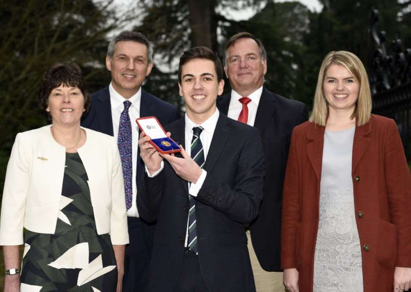 Owen Dewey with the 2017 gold medal award from The Queen after he achieved the highest A-level grades at KES''left to right Jane Dewey, Lloyd Brown, Owen Dewey, Chris Dewey and Kate Dewey
