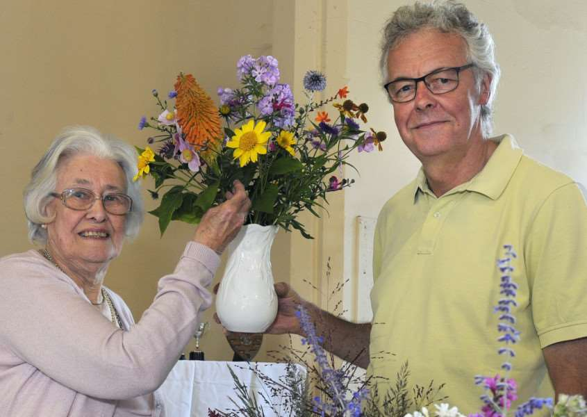 Castle Acre Horticultural Society Show at Castle Acre Village Hall'Castle Acre Horticultural Society President Betty Desborough and Chairman Richard Jenney with one of the winning displays.