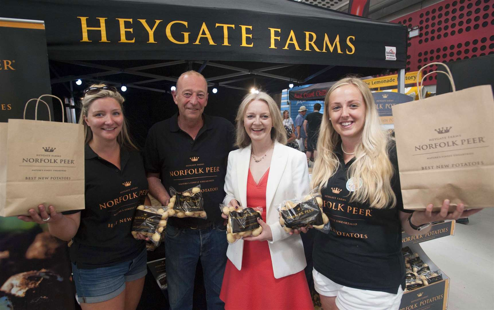 MP Elizabeth Truss at The Royal Norfolk Show Pictured with local Business Heygate Farms. FLtoR Jess Green. William Gibbon. Elizabeth Truss (MP), and Leah Richardson. (2788458)