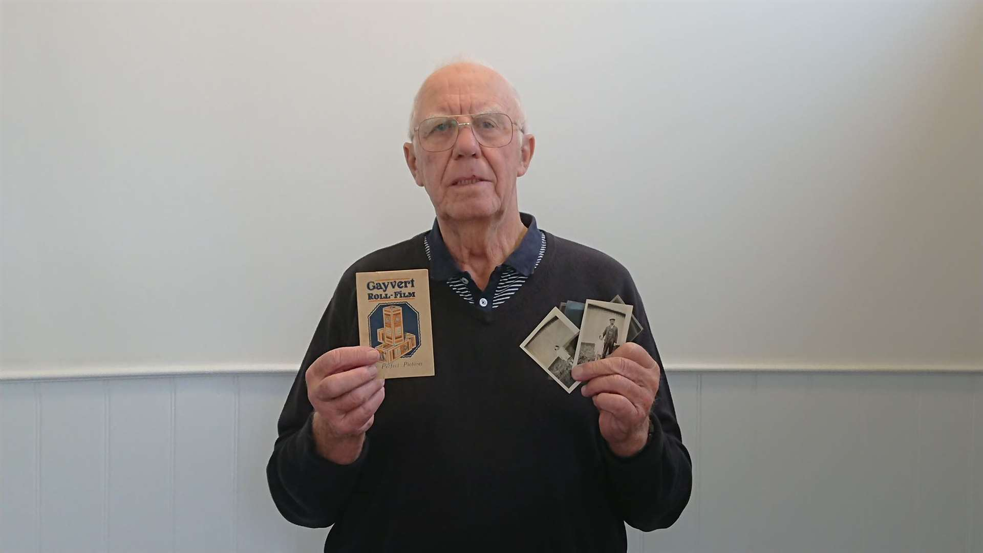 Harry Everett with the pictures found by his wife in a tin, purchased from a car boot