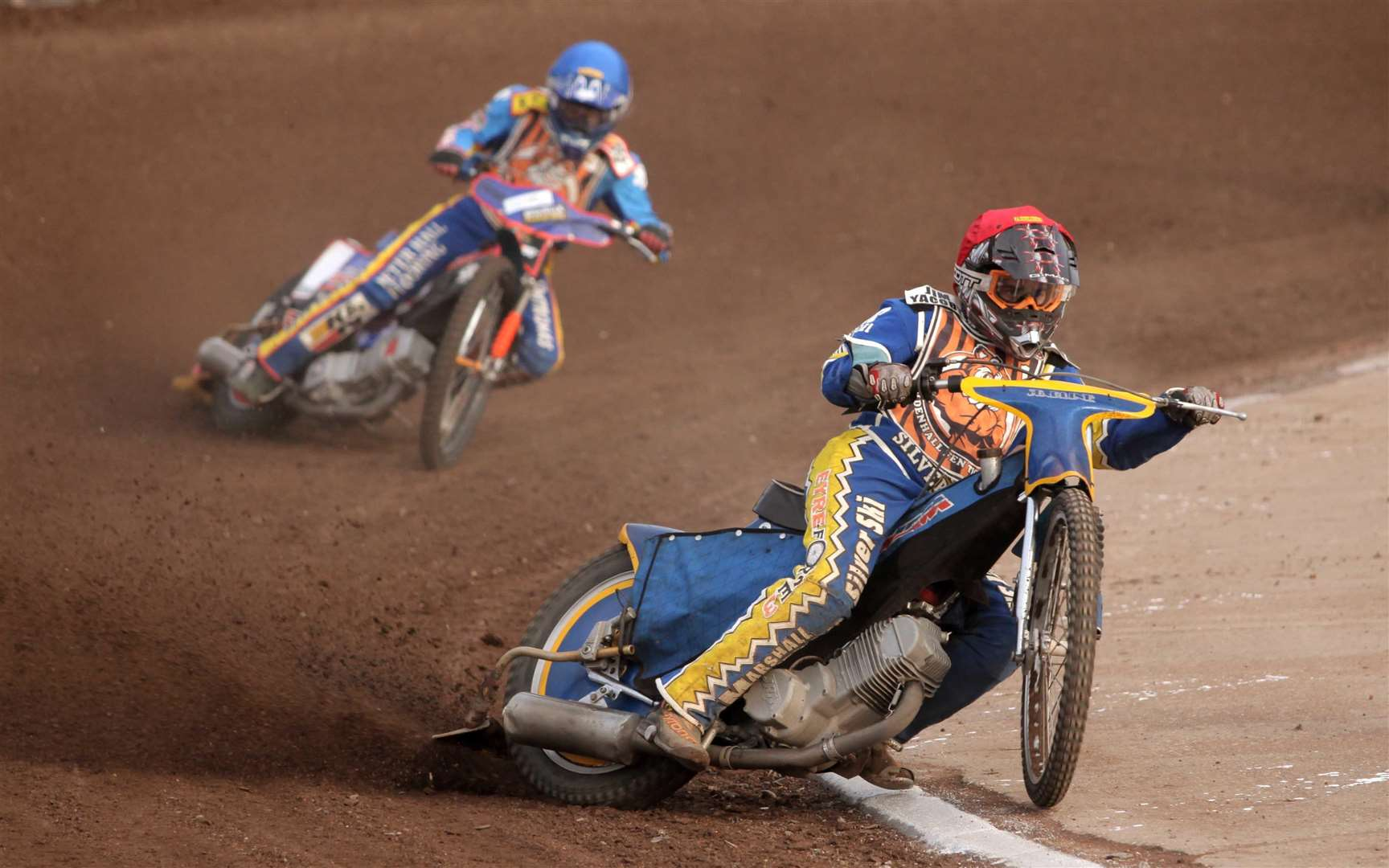 Newmarket Journal - October 2012..Fen Tigers v Dudley Heathens.Jason Garrity leads Joe Jacobs. (3105295)