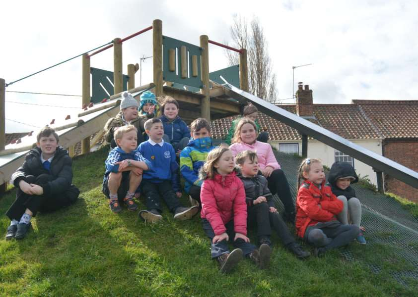 Burnham Market Primary School pupils who helped choose the play area equipment watch the opening ceremony