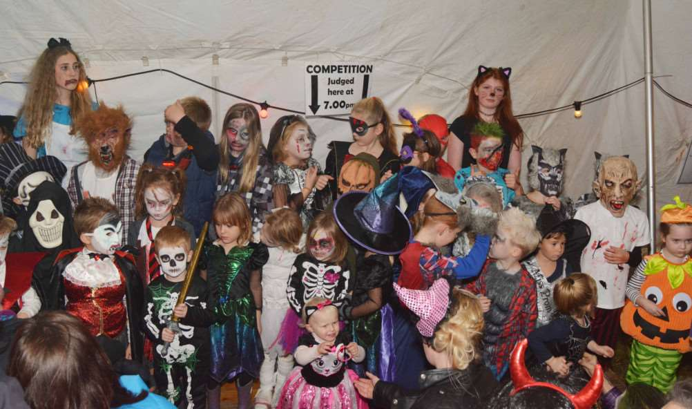 West Acre Bonfire'Junior fancy-dress entrants were so numerous there was hardly room for them on stage