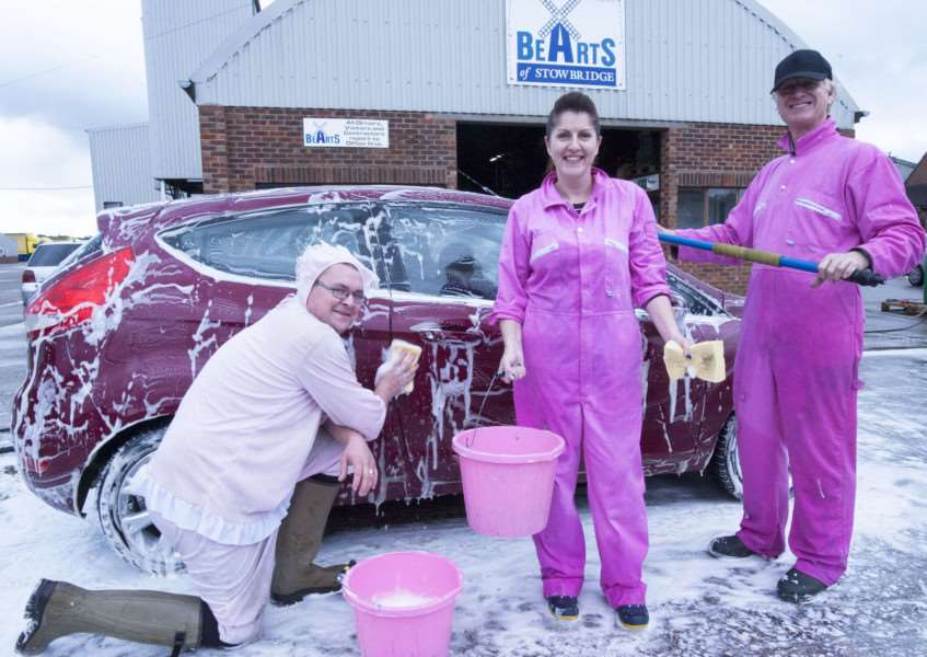 Bearts of Stowbridge King's Lynn Holds Charity Car Wash IAO Cancer UK.Pictured FLtoR Daniel Cole. Debbie Britton. Stephen Brighton. at Bearts Stowbridge.