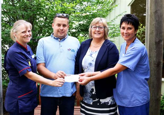 6a4a03dfc8a Oliver and Sally Warner present cheque to nurses from the Critical Care  Unit at the QEH