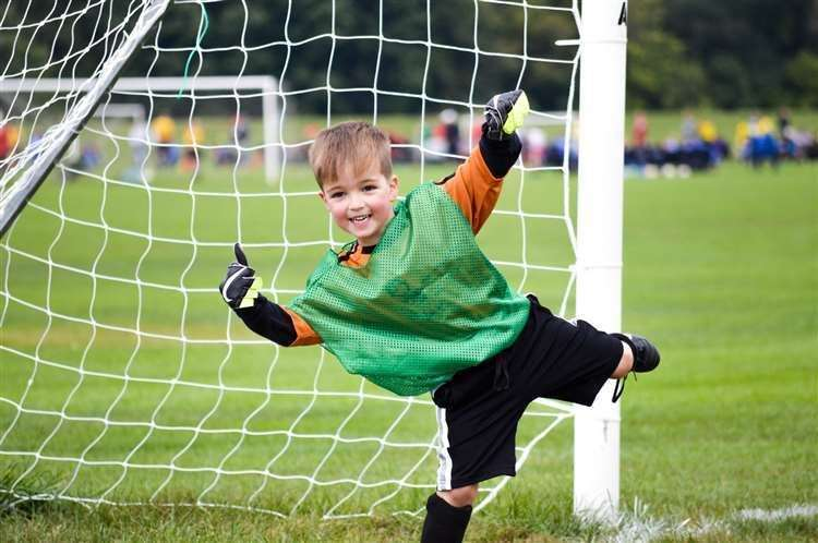 Young children won't be able to head the ball during football training.