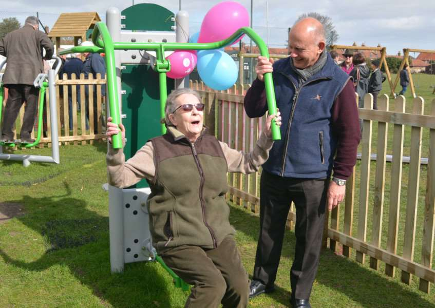 Parish council deputy chairman, Jane Murphy, tries out one of the pieces of gym equipment watched by past chairman, Geof Hanley