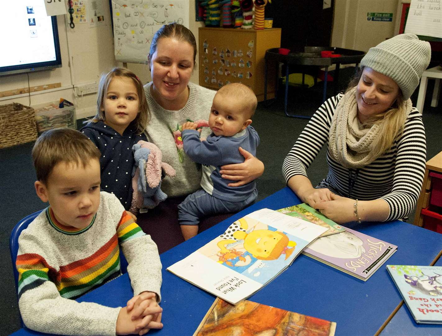 Bonfire and Books at Swaffham Infant School. Pictured right teacher Holly Black with children and parents reading stories