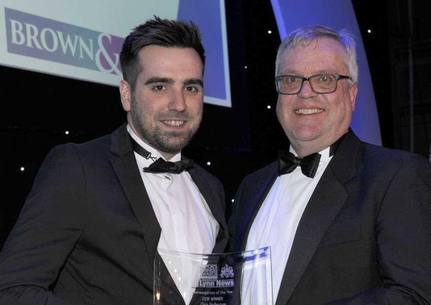 Businessperson of The Year Winner Chris Girdlestone of HUT42 collects his award from John Weston, of sponsors Brown and Co