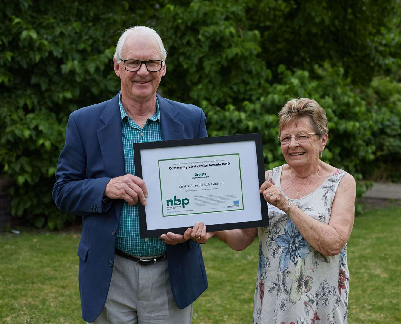 Ian Gosling and Ros Pugh from Snettisham Parish Council with their Biodiversity Award (13951454)