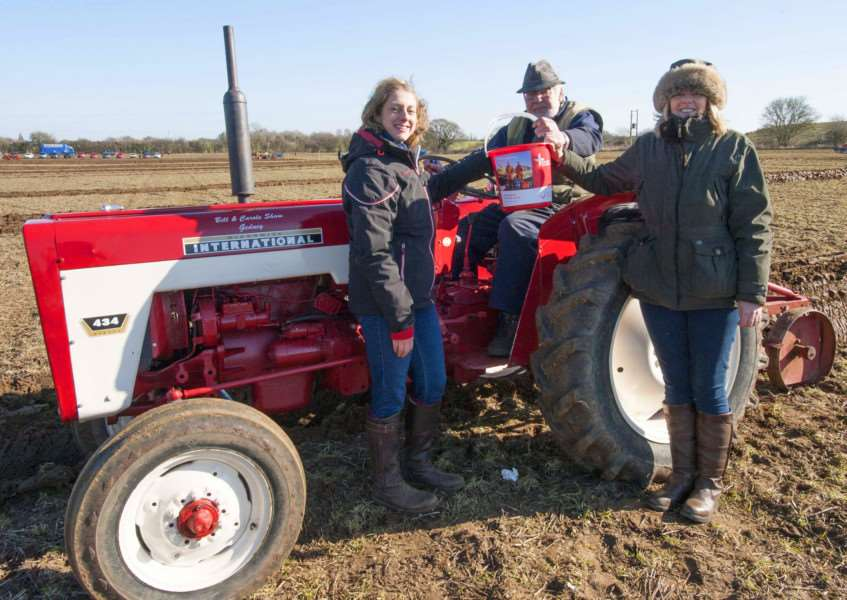 Charity Ploughing Match at Hall Farm Roydon IAO East Anglian Air Ambulance .Pictured FLtoR Emma Pickering (Organiser) Gerry Hutchinson (Veteran Plougher) Karen Wix (Organiser)