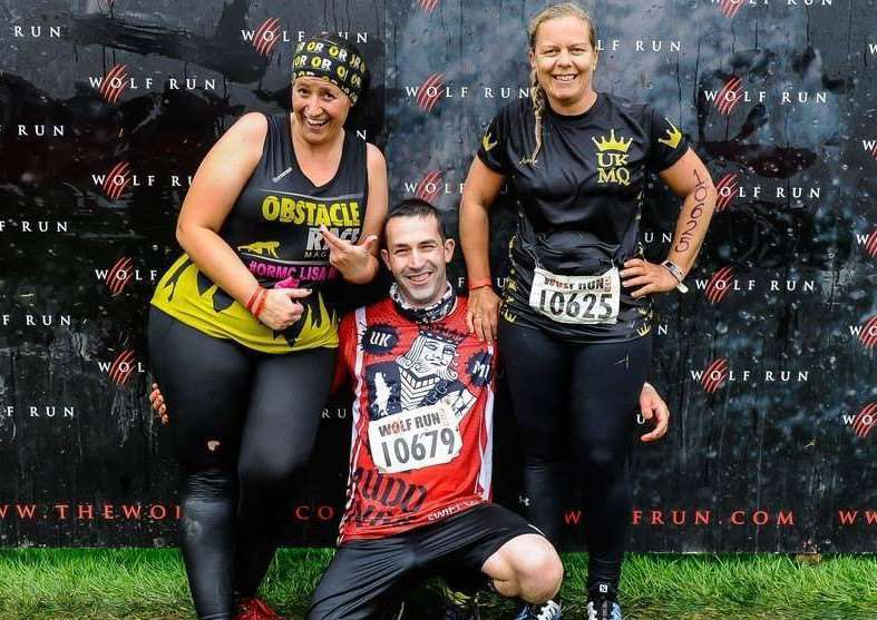 MUD RUNNER: Adrian Pitt, with fellow OCR racers Lisa Caswell and Sarah Blackburn, wants people to try out the sport in Kettering next month. Photo supplied.