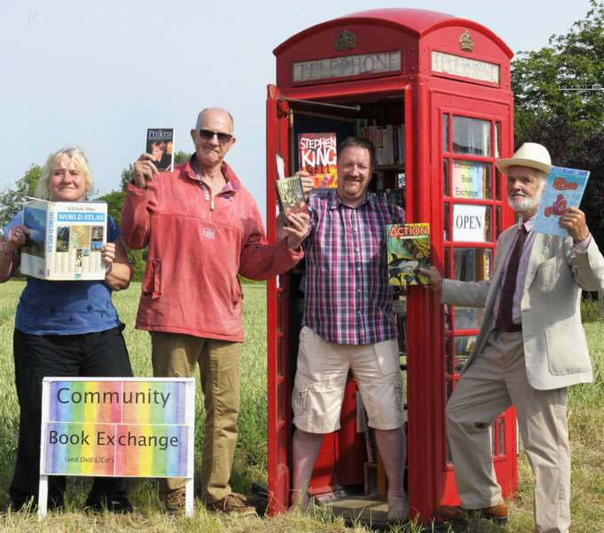 Official opening ofthw book exchange in Old Telephone Box at Common Road, Wiggenhall St Mary. 'The newly restored Red Telephone Box, LtoR, Alison Ravnkilde, Andy Hillard, Alastair Done (St Germans Parish Council Chairman who opened the Telephone Box), John Ravnkilde.