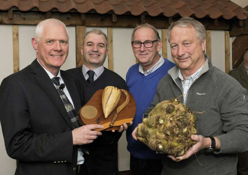 Annual Sugar Beet Competition for Stoke Ferry Agricultural Society. Pic of winners and guest speaker Colm McKay, agricultural director of British Sugar. 'LtoR, Colm McKay (British Sugar), Paul Wortley (SFAS Chairman and 3rd place award), Roger Eyles (2nd place award), Jon Lowe (winner)