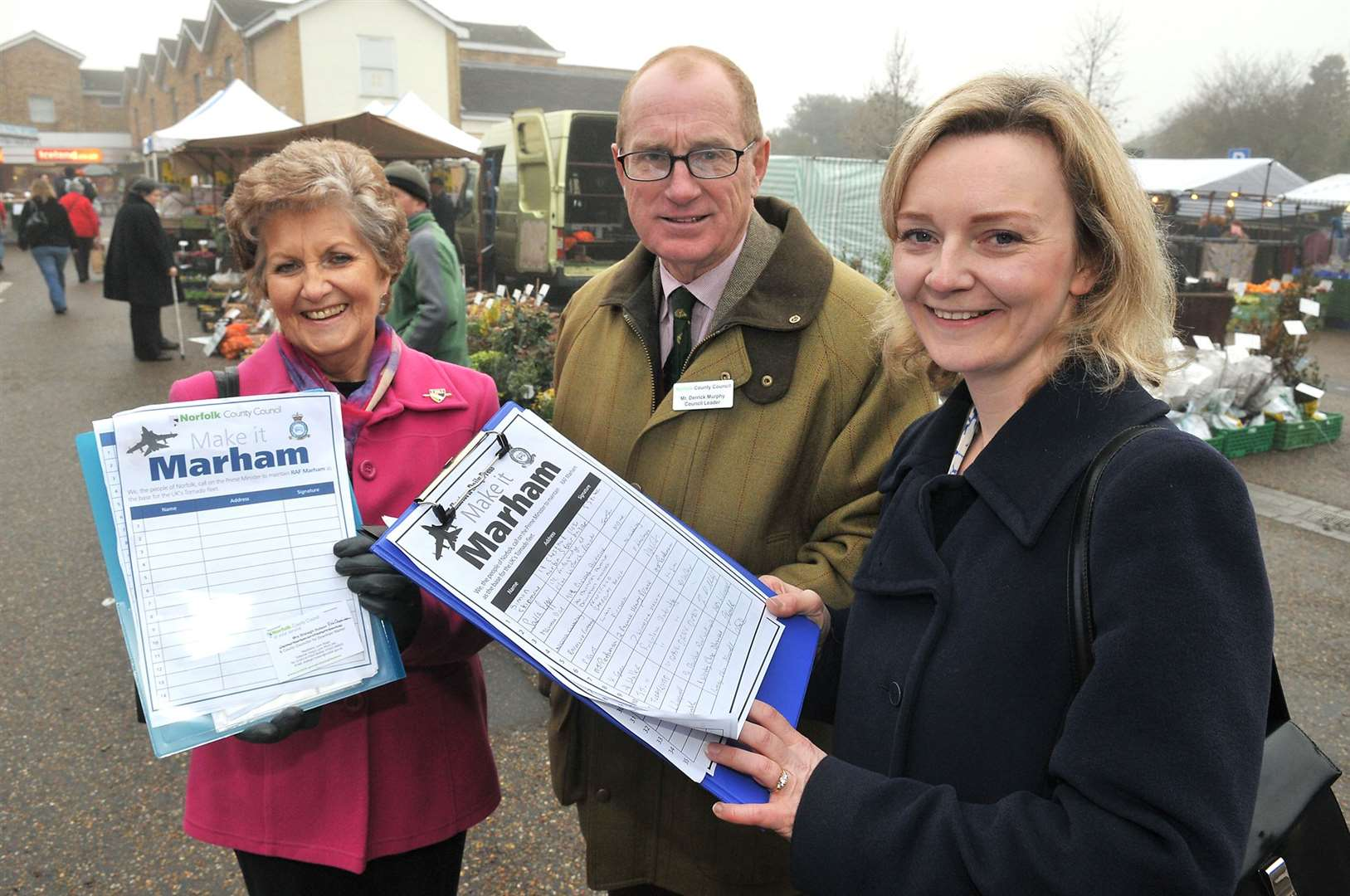 Former Norfolk County Council leader Derrick Murphy, seen here, centre, campaigning to save RAF Marham with MP Liz Truss, right, has died.