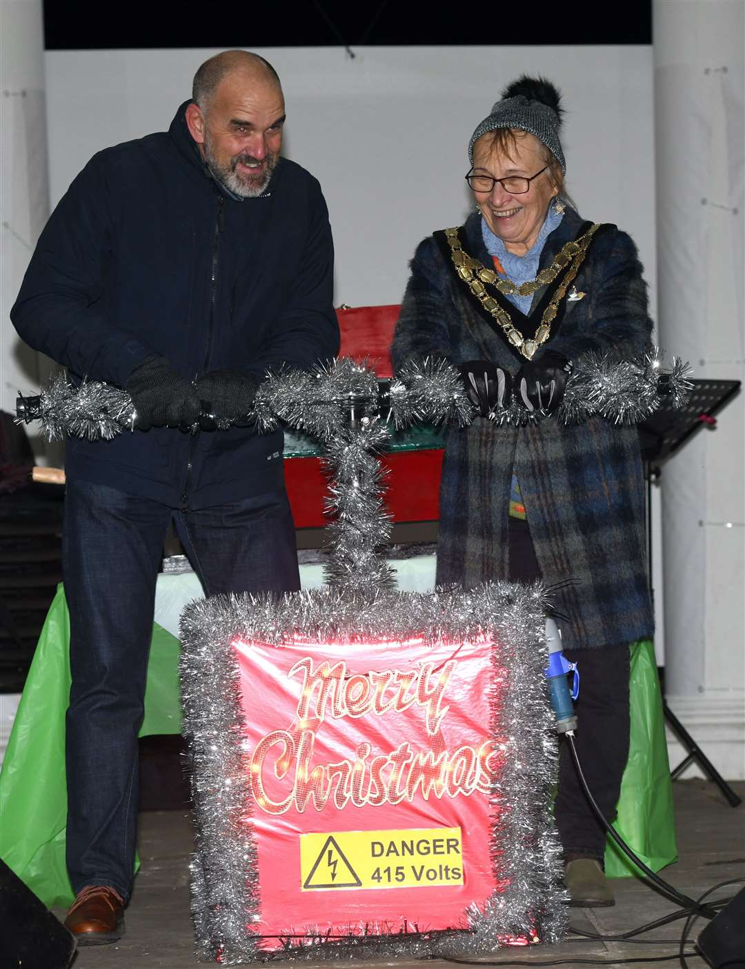 Colin Rigby and Swaffham mayor Jill Skinner turn on the lights