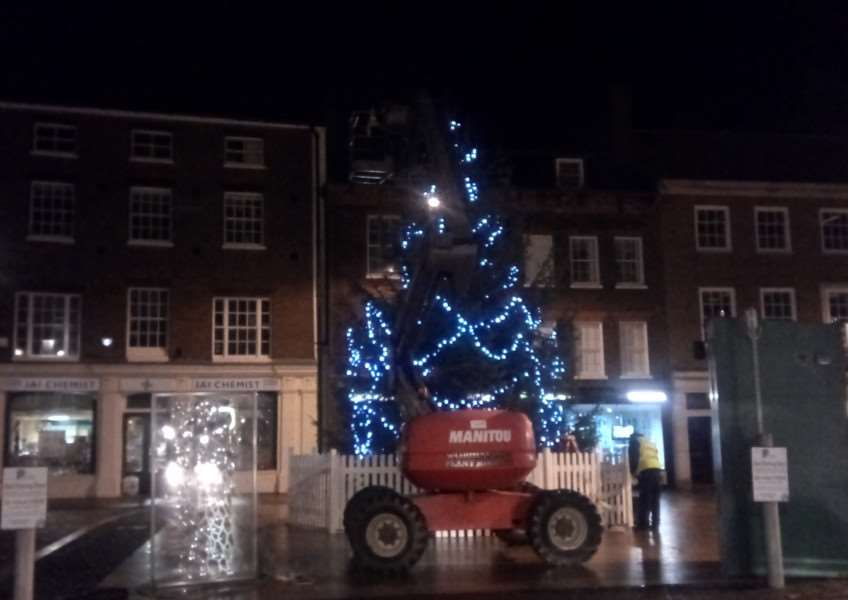 Workmen put the lights on the Christmas tree in Tuesday Market Place on Monday, November 20, 2017.