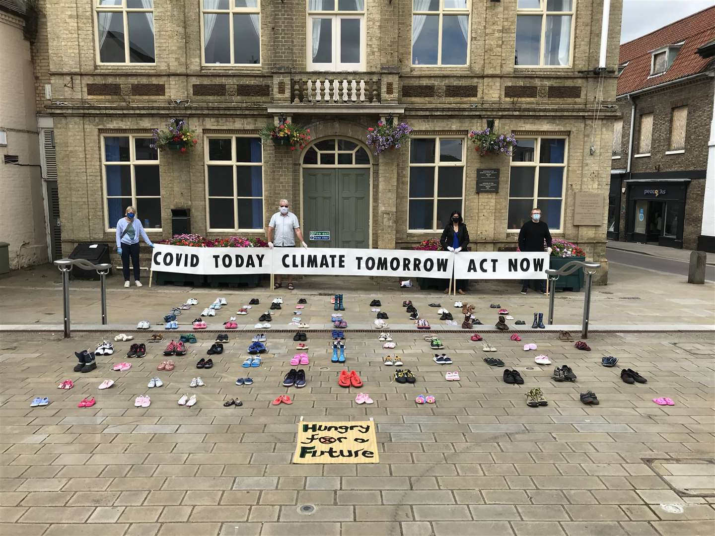 Pairs of children's shoes were laid outside Downham Town Hall as part of an Extinction Rebellion climate change protest. Picture: SUBMITTED