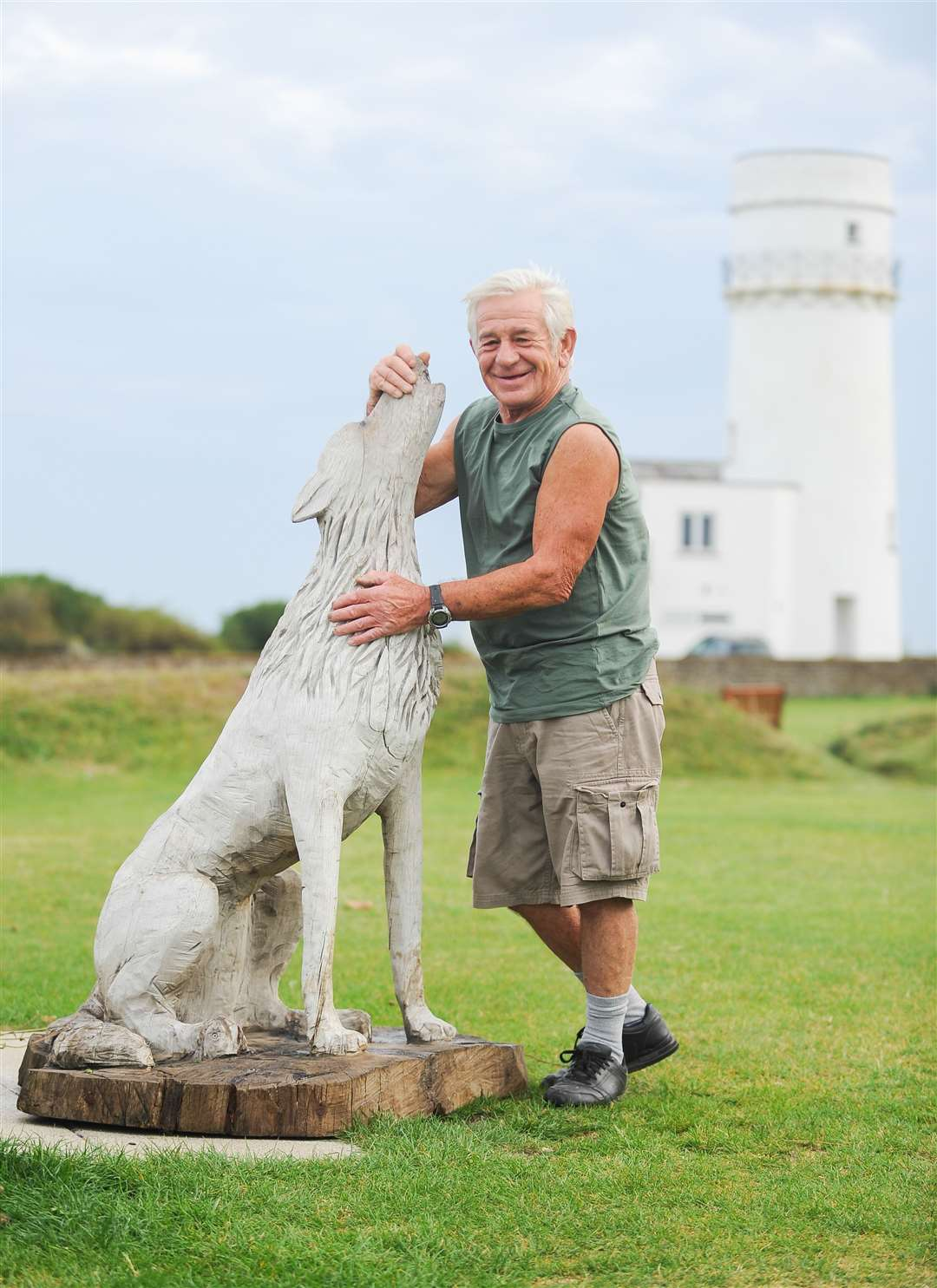 Mick Smith with the repaired wolf sculpture that is now back in place near the The Lighthouse in Old Hunstanton.. (15830722)