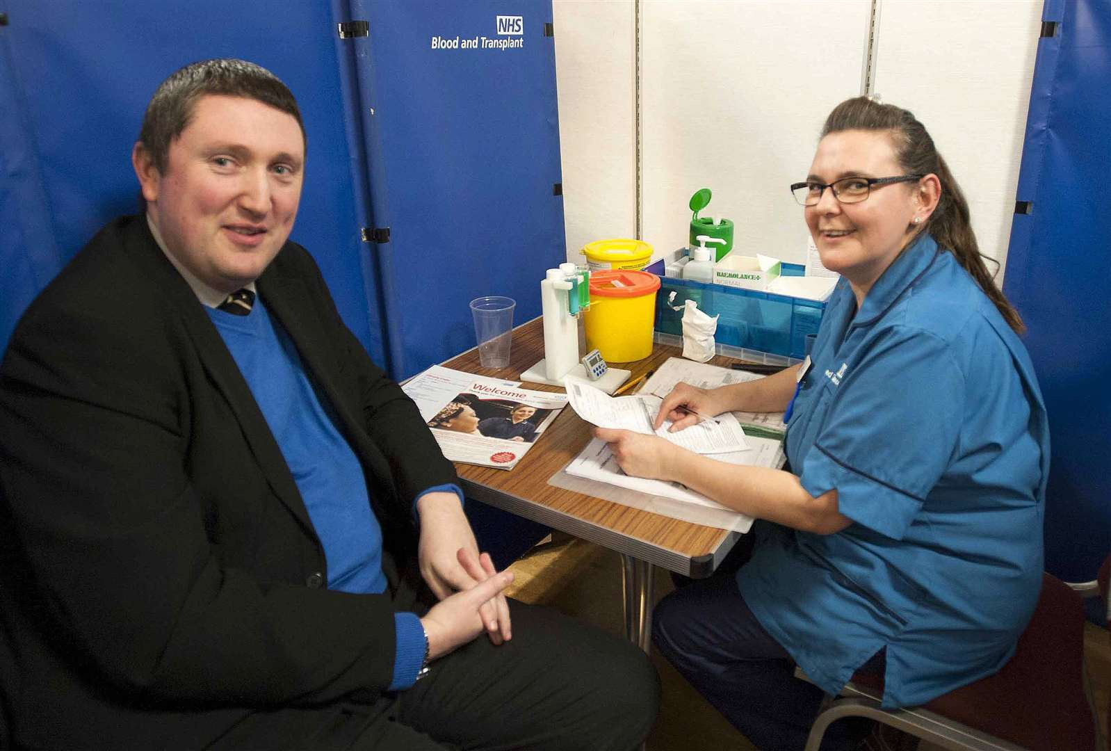 Lynn News News Editor Alister Webb set to become a New Blood Donor. Pictured Allister with Nurse Sarah Sarah Parfitt.at The Blood Donor session King's Centre King's Lynn. (7421608)
