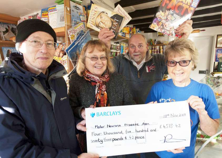 Ali Dent and Family present a Cheque to MNDA Association from book sale. A.J Dents Hilgay. Pictured FLtoR Desmond Dent. Lesley Dent.'Ali Dent. Jane Lewis (MNDA Association)